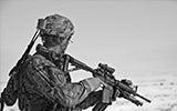 Soldier in desert in camouflage gear