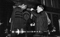 Georgetown President Timothy S. Healy, S.J., awards the President's Medal to men's basketball coach John Thompson, Jr., in 1982