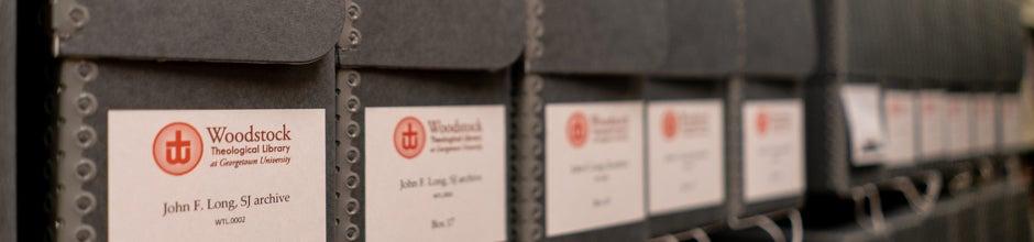 Archival Hollinger boxes receding on shelf