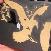 Close up image of a laser cut design featuring birds