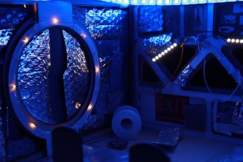 Laser Cut set of sci-fi scene, lit with blue leds